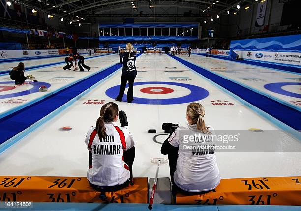 Lene Nielsen and Jeanne Ellegaard of Denmark wait for Scotland to throw a stone in the match between Scotland and Denmark on Day 5 of the Titlis...