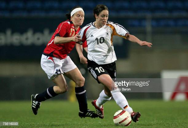 Lene Storlokken of Norway challenges Renate Lingor of Germany for the ball during the Algarve Cup match between Germany and Norway on March 7, 2007...