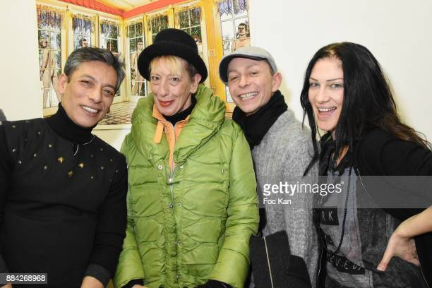 Lenedy Angot Ouamee Schlumberger Lola Mercier and Caroline Lauzain attend Lenedy Angot Calendar 2018 launch at Galerie Fabrice Hybert on December 1...