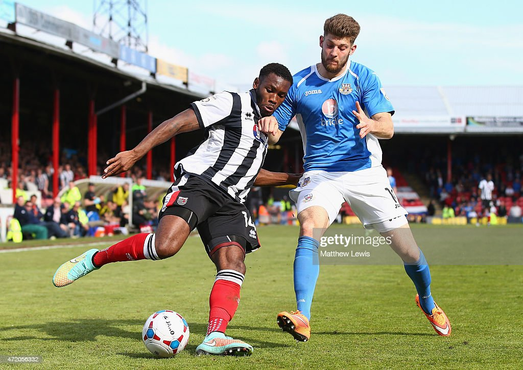 Lenell John-Lewis of Grimsby Town and Will Evans of Eastleigh challenge for the ball during the Vanarama Football Conference League match between Grimsby Town and Eastleigh FC at Blundell Park on May 3, 2015 in Grimsby, England.