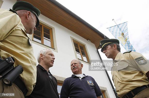 Police officers Gerhard Eichberger Ruediger Kort foundation member Helmuth Scharnagel and police officer Guenter Hackenberg talk as they stand in...