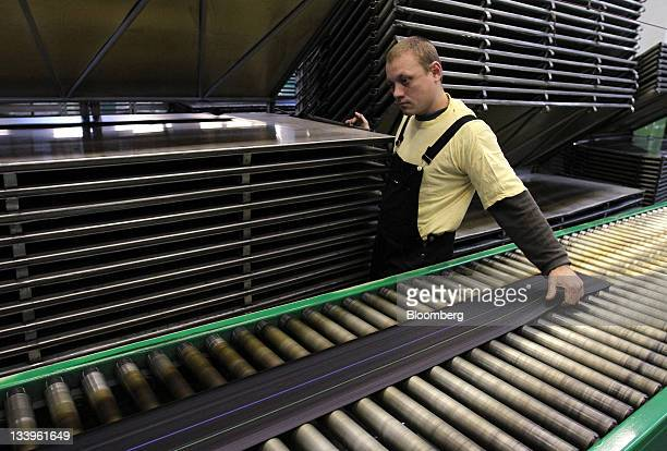 Length of tire tread passes along the production line at the ZAO Sibur Holding tire manufacturing plant in Voronezh, Russia, on Friday, Nov. 18,...