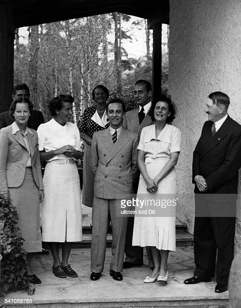 Leni Riefenstahl * Film director and actress dancerin front of her house in Berlin Dahlem Front row from right Adolf Hitler Leni Riefenstahl Joseph...