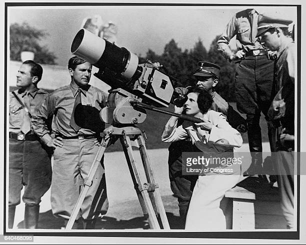 Leni Riefenstahl and camera director Sepp Allgeier film Triumph of the Will on a street in Nuremberg during the 1934 Nazi Party Congress