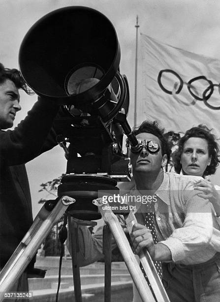'Leni Riefenstahl German photographer director and actress with cameraman Hans Ertl during the shooting of her twopart Olympicgames movie in Berlin...