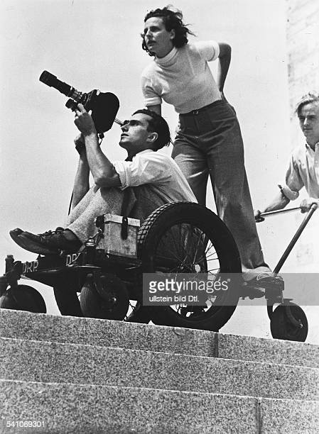 Leni Riefenstahl, German photographer, director and actress, with cameraman Walter Frentz during the shooting of her two-part Olympic-games movie in...