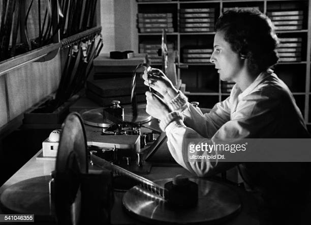 Leni Riefenstahl Leni Riefenstahl * Film director and actress photographer Germany Leni Riefenstahl at her home in Berlin doing cutting work for her...
