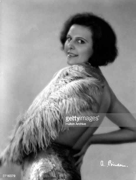 Leni Riefenstahl , the German actress and director, wearing a feather boa.
