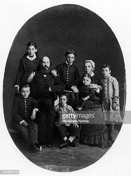 Lenin as a child posing with his parents and his brothers and sisters Russia 1879