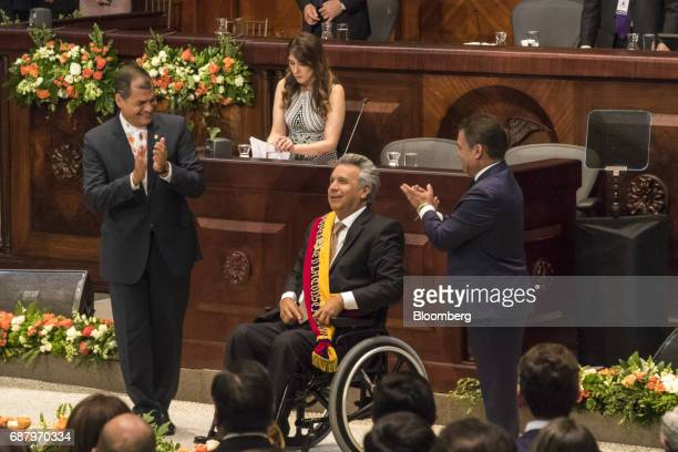 Lenin Moreno Ecuador's president center reacts as former Ecuadorian president Rafael Correa left applauds during the presidential inauguration at the...