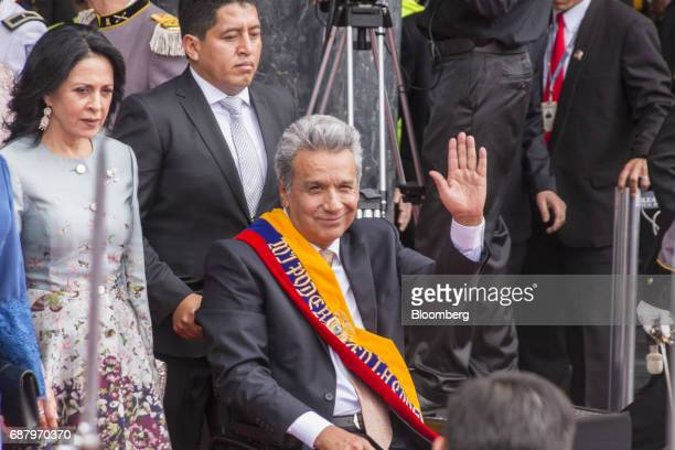 Lenin Moreno Ecuador's president center waves while exiting the National assembly building after the presidential inauguration in Quito Ecuador on...