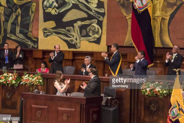 Lenin Moreno Ecuador's presidentelect center left reacts as former Ecuadorian president Rafael Correa center right and attendees applaud during the...