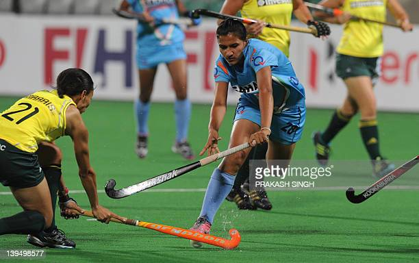 Lenise Marais of South Africa blocks Rani Rampal of India during the women's hockey match between India and South Africa of the FIH London 2012...