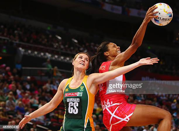 Lenize Potgieter of South Africa and Geva Mentor of England compete for the ball during the 2015 Netball World Cup match between England and South...