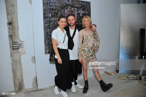 Lenka Havlicek with artists Maxim and Karen Bystedt at Karen Bystedt's 'Kings And Queens' exhibition on March 9 2017 in Los Angeles California