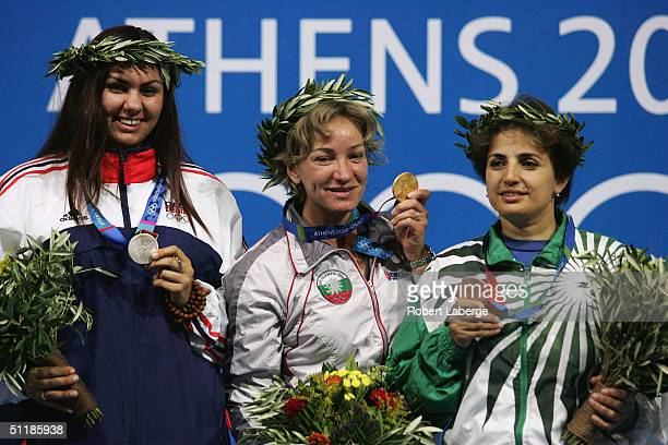 Lenka Hykova of the Czech Republic Maria Grozdeva of Bulgaria and Irada Ashumove of Azerbaijan on the podium after respectively the Silver Gold and...