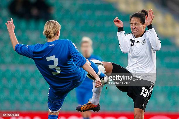 Lenka Mravikova of Slovakia competes for the ball with Celja Sasic of Germany during the FIFA Women's World Cup 2015 Qualifier between Slovakia and...