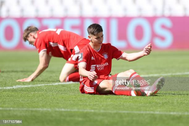 Lenn Jastremski of Bayern München reacts with his team mate Nemanja Motika during the 3. Liga match between Bayern München II and SpVgg Unterhaching...