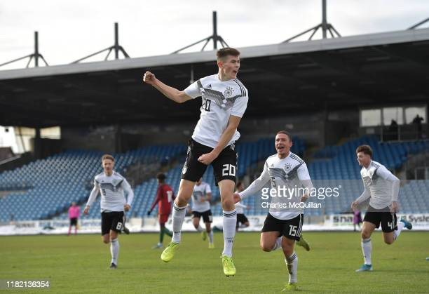 Lenn Jastremski of Germany celebrates with team mates after scoring during the u19 international friendly between Germany and Portugal at the...