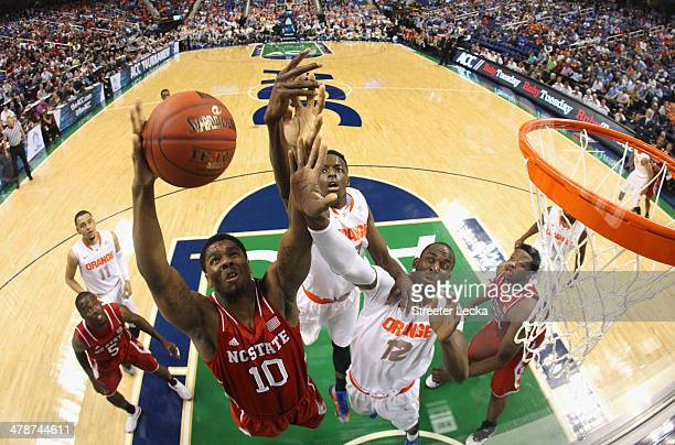 Lennard Freeman of the North Carolina State Wolfpack battles for a loose ball against teammates Rakeem Christmas and BayeMoussa Keita of the Syracuse...
