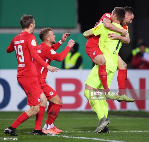 Lennart Grill of 1. FC Kaiserslautern is congratulated after a penalty shoot out by his team mates during the DFB Cup second round match between 1....