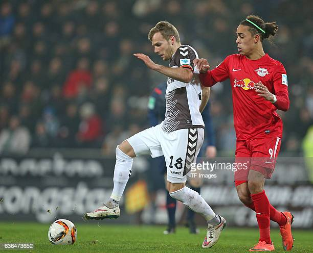 Lennart Thy of St Pauli and Yussuf Poulsen of RB Leipzig battle for the ball during the Second Bundesliga match between FC St Pauli and...