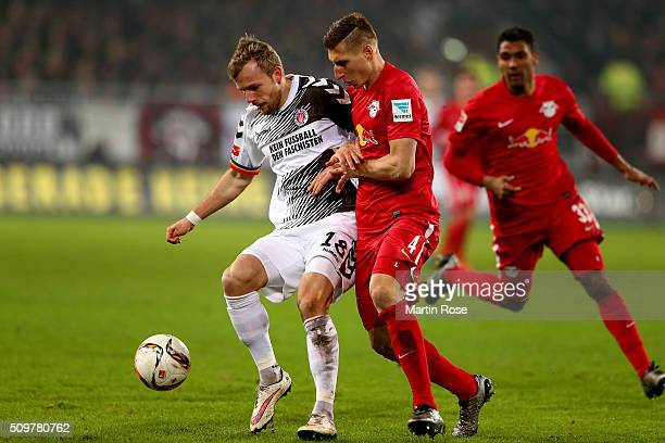 Lennart Thy of St Pauli challenges for the ball with Willi Orban of Leipzig during the second Bundesliga match between FC St Pauli and RB Leipzig at...