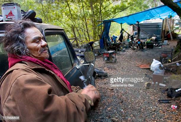 Lennie Butch Reed works in the yard of his small tract of land he lives on the Yurok reservation January 10 2007 Reed is known around the area as a...