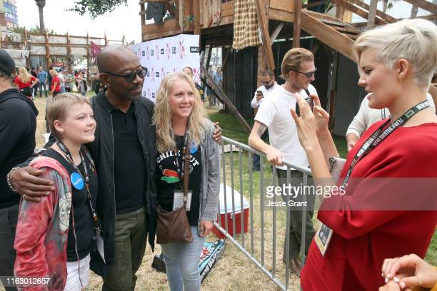 Lennie James and Maggie Grace meet fans at AMC's Deadquarters at Comic Con 2019 on July 19, 2019 in San Diego, California.