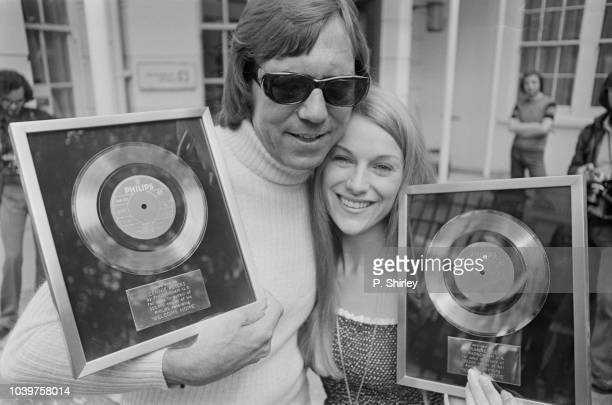 Lennie Peters and Dianne Lee of British pop duo Peters and Lee pictured together with their silver discs awarded to celebrate the success of their...