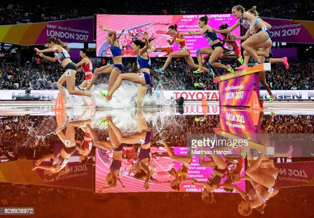Lennie Waite of Great Britain and others jump the hurdle at water jump as they compete in the Women's 3000 metres Steeplechase heats during day six...