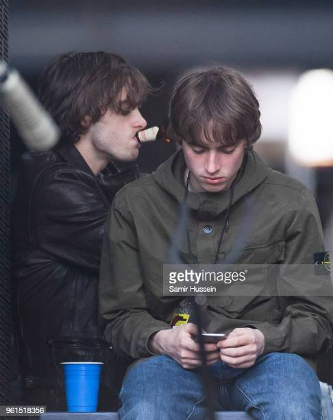 Lennon Gallagher and Gene Gallagher watch their father Liam Gallagher perform perform live on stage at London Stadium on May 22 2018 in London England