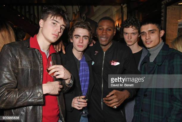 Lennon Gallagher and Tafari Hinds attend the LOVE and MIU MIU Women's Tales Party at Loulou's on February 19 2018 in London England