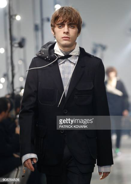 Lennon Gallagher the son of Oasis frontman Liam Gallagher presents creations by Lanvin during men's Fashion Week for the Fall/Winter 2018/2019...