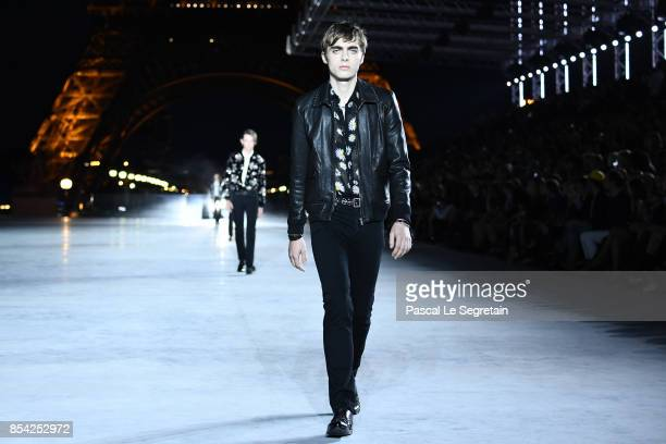 Lennon Gallagher walks the runway during the Saint Laurent show as part of the Paris Fashion Week Womenswear Spring/Summer 2018 on September 26 2017...
