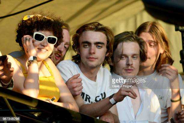 Lennon Gallagher watches Richard Ashcroft support Liam Gallagher from the side of the stage at Finsbury Park on June 29 2018 in London England