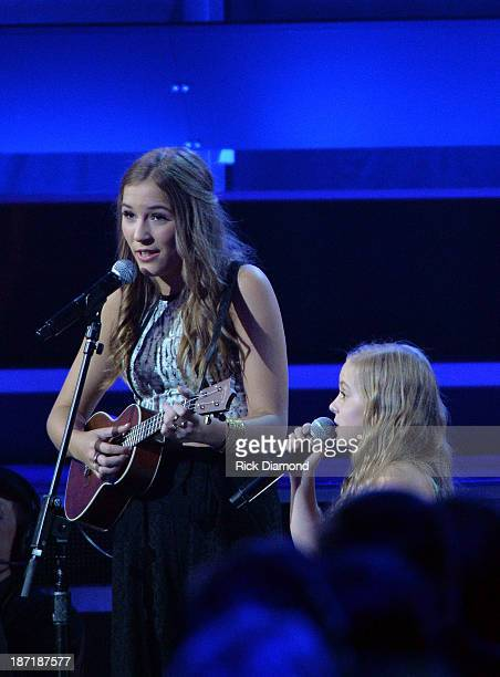 Lennon Stella and Maisy Stella perform onstage during the 47th annual CMA Awards at the Bridgestone Arena on November 6 2013 in Nashville Tennessee