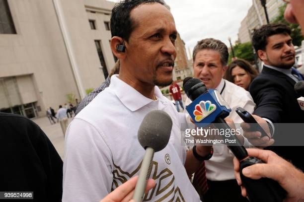 Lennox Jones speaks outside the H Carl Moultrie Courthouse of the District of Columbia after five men were found guilty of murder in a series of...