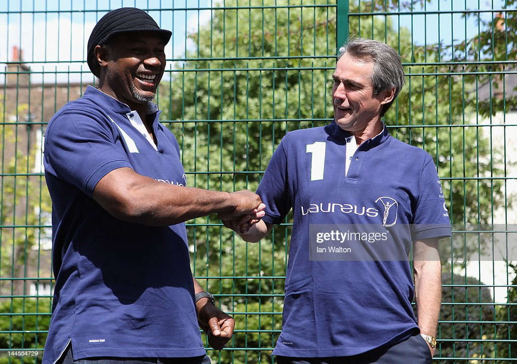 Lennox Lewis and Alan Hansen pose for photographs during a visit to a Laureus Street League project at the Calthorpe Project on May 16, 2012 in London, England. As a follow up to the 2012 Laureus World Sport Awards in London the decision was taken to follow up with guests and invite them to take part in Foundation events and visit projects. This is particularly with the view of developing more Academy Members and Ambassadors. This will be the first time that Laureus has visited Street League since funding started in 2009.