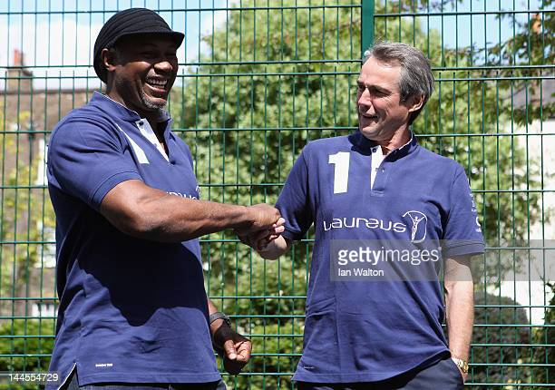 Lennox Lewis and Alan Hansen pose for photographs during a visit to a Laureus Street League project at the Calthorpe Project on May 16 2012 in London...