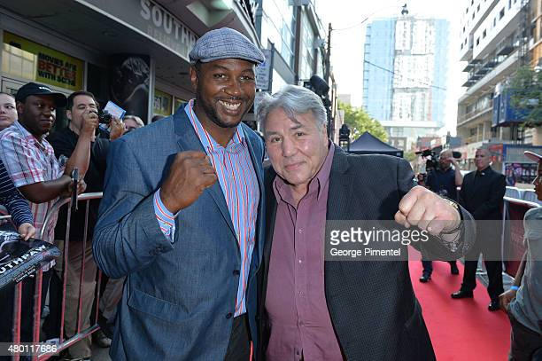 Lennox Lewis and George Chuvalo attend the Canadian Premiere of 'Southpaw' at Scotiabank Theatre on July 9 2015 in Toronto Canada