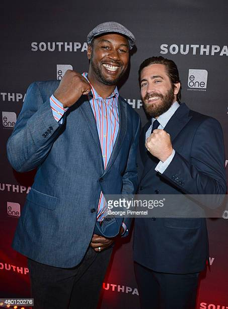 Lennox Lewis and Jake Gyllenhaal attend the Canadian Premiere of 'Southpaw' at Scotiabank Theatre on July 9 2015 in Toronto Canada