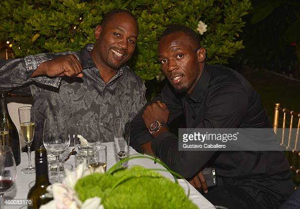 Lennox Lewis and Usain Bolt attend Haute Living 10th Year Anniversary Party on December 6 2014 in Miami Florida