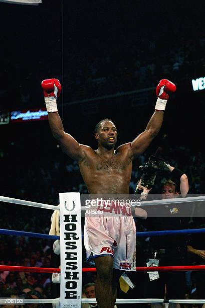 Lennox Lewis celebrates his victory over Mike Tyson during their WBC/IBF heavyweight championship bout on June 8, 2002 at The Pyramid in Memphis,...