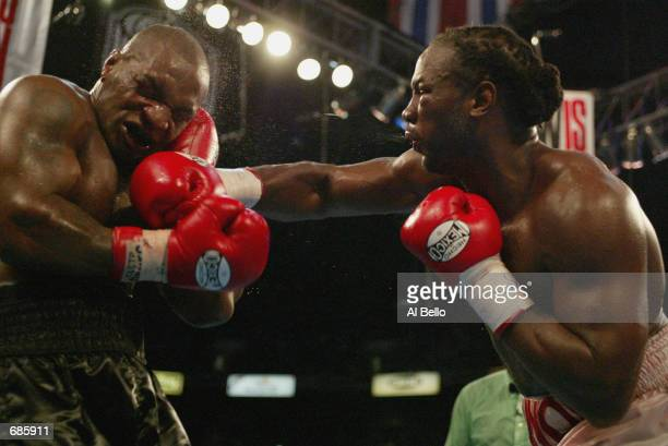 Lennox Lewis hits Mike Tyson with a right hook in the 8th round during their WBC/IBF heavyweight championship bout on June 8 2002 at The Pyramid in...