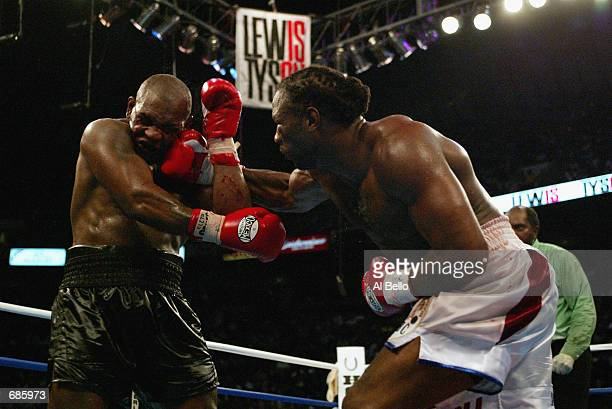 Lennox Lewis hits Mike Tyson with a right hook in the 8th round during their WBC/IBF heavyweight championship bout on June 8, 2002 at The Pyramid in...