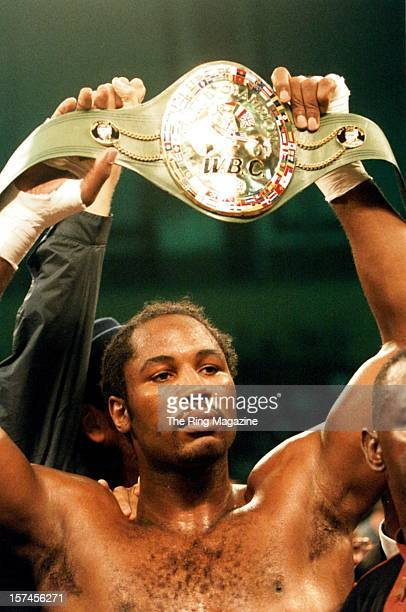 Lennox Lewis holds up his WBC title belt after winning the fight against Andrew Golota at the Caesar's Hotel Casino on October 41997 in Atlantic City...