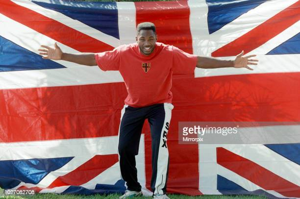 Lennox Lewis poses with a hug England flag ahead of his WBC world title fight with Tony Tucker Circa May 1993