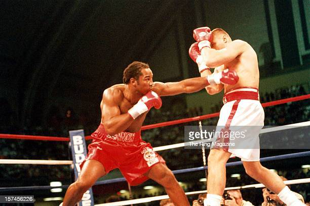 Lennox Lewis throws a left hook against Andrew Golota during the fight at Caesar's Hotel Casino on October 41997 in Atlantic City New Jersey Lennox...