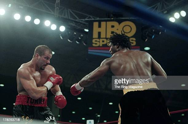 Lennox Lewis throws a punch against Tommy Morrison during the fight at the Convention Center Atlantic City New Jersey Lennox Lewis won International...